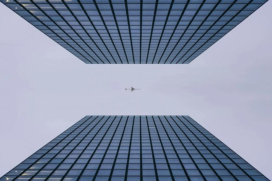 buildings with plane between