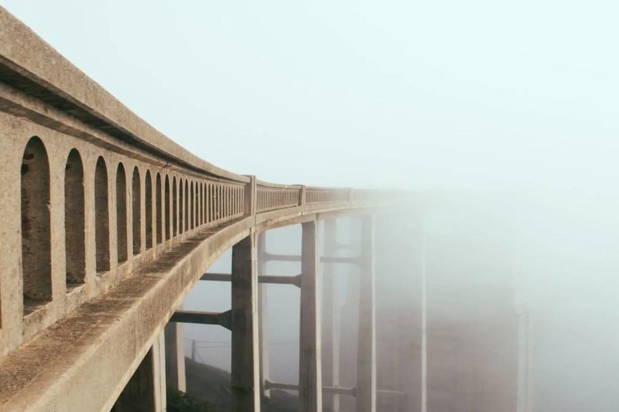 bridge disappears into fog