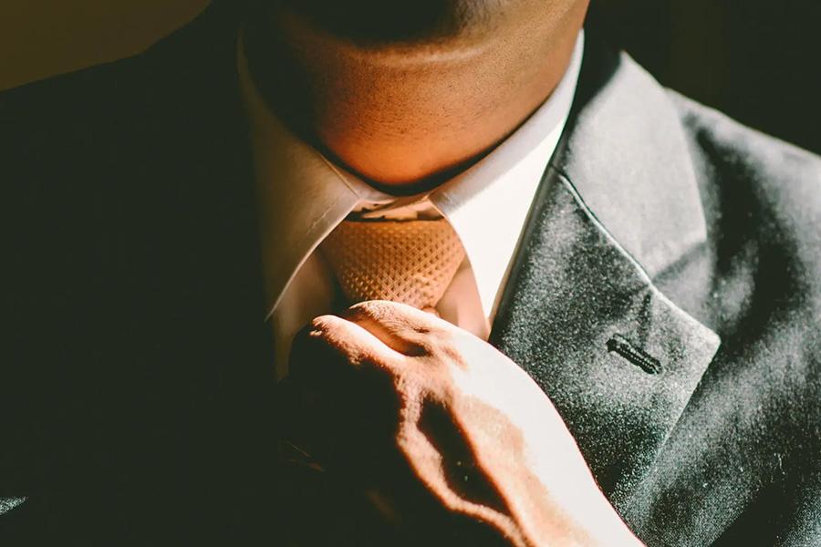 portfolio manager tightening tie