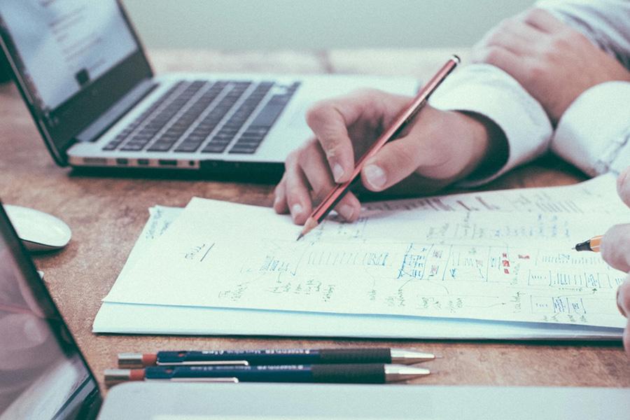 portfolio managers collaborating on workflows