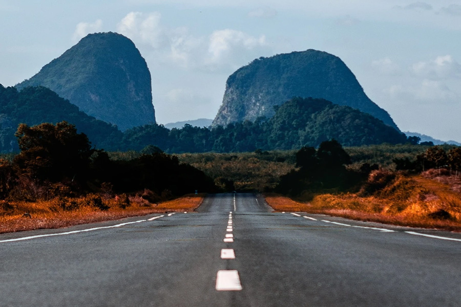 road with buttes in distance