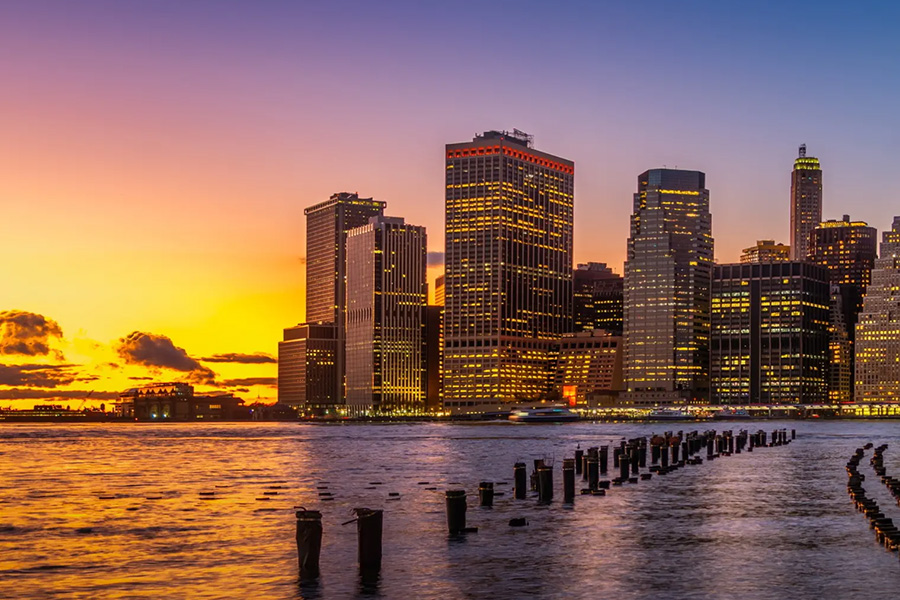 city skyline on coast at sunset