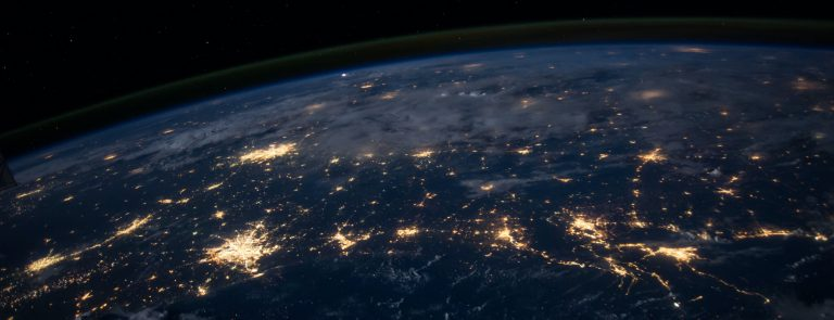 earth with cities lit up