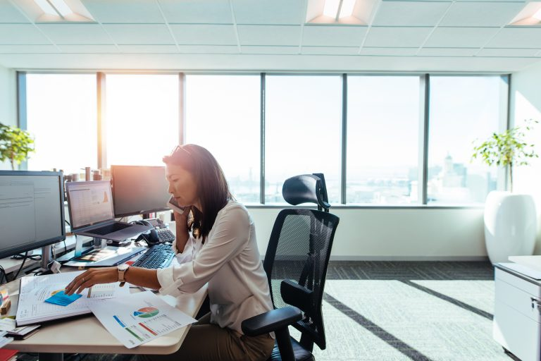 asian woman sitting at work desk