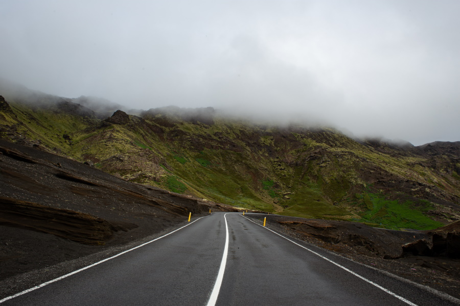 road with clouds in distance